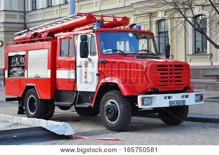 KYIV UKRAINE - January 19 2019: Red colorful firetruck Kraz ride on call fire suppression