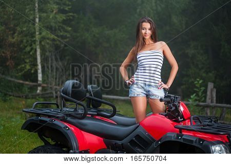 Beautiful Girl On Four-wheeler Atv
