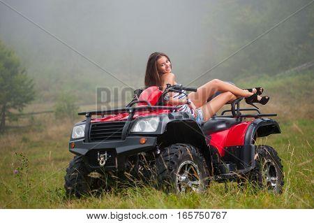 Beautiful Girl On Four-wheeler Atv