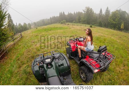 Pretty Lady Driving Four-wheelers Atv In Foggy Nature
