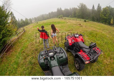 Happy Beautiful Couple Standing Near Four-wheelers Atv