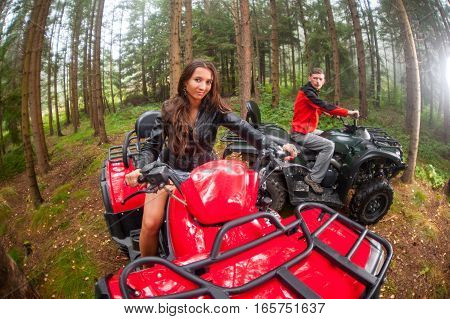 Happy Beautiful Couple Driving Four-wheelers Atv