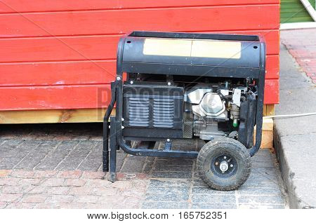 Gasoline Powered Portable Generator. Diesel Generator on the Construction Site