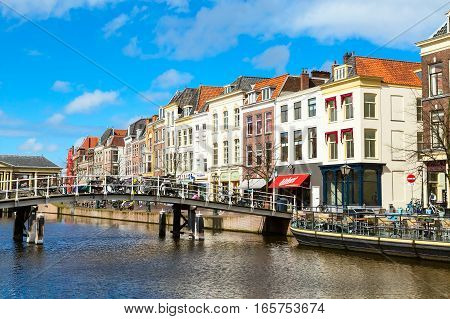 Leiden, Netherlands - April 7, 2016: Traditional houses, bridge and bicycles in downtown of Leiden, Holland