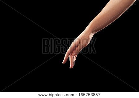 Closeup of female dancer hand in ballet position on black background