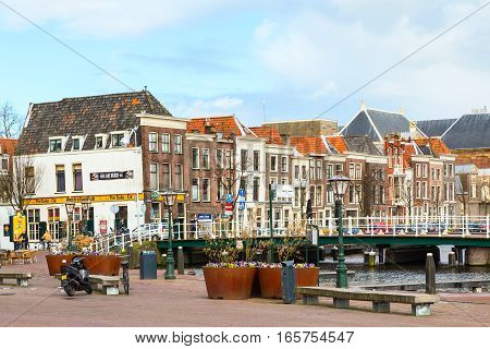 Leiden, Netherlands - April 7, 2016: Traditional houses and bicycles at the square in Leiden, Holland, Netherlands