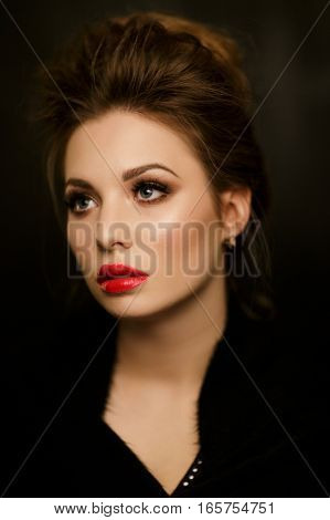 Portrait of beautiful girl with red lips in studio