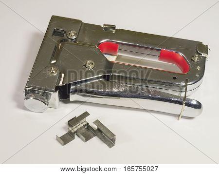 The staple gun on a white background