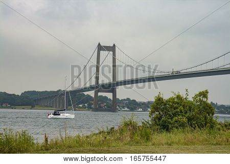 Sailboat passing a bridge at Fyen Denmark