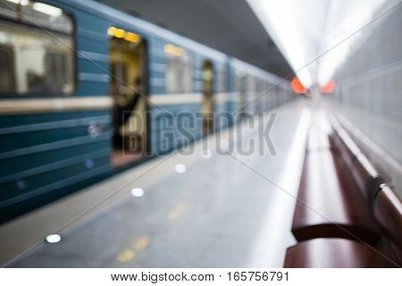 Defocused picture of metro with moving train inside tunnel