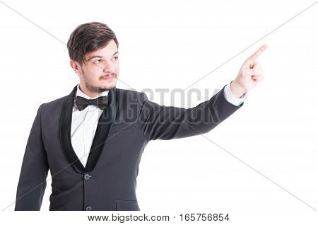 Handsome Man Wearing Tuxedo And Bowtie Pointing