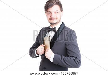 Handsome Man Wearing Tuxedo And Bowtie Holding Notebook