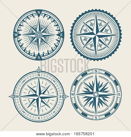 Vintage marine compass logo set. Symbol of retro win rose. Vector illustration