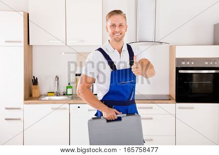 Portrait Of Happy Male Worker With Toolkit