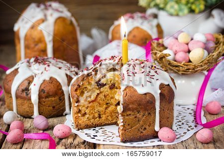 Easter cake and colorful chocolate candy eggs on festive Easter table