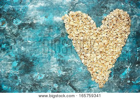 Oat flakes heart raw oatmeal top view