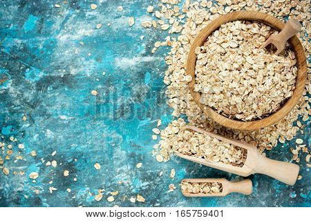 Oat flakes oatmeal healthy food concept top view