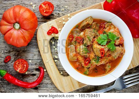 Meat goulash pork stew with red bell pepper and tomatoes gravy sauce