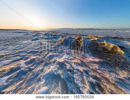 Aerial Panorama Of Snow Sunrise Wave On The Shore Of Olkhon. Baikal