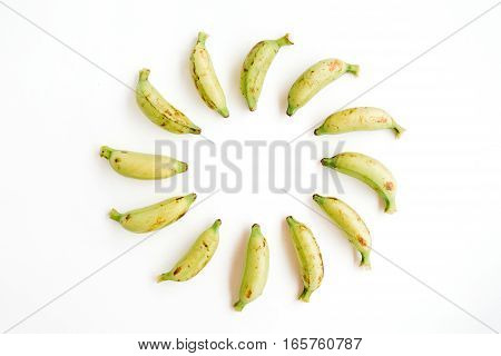 Round frame made of bananas. Flat lay top view. Creative food concept