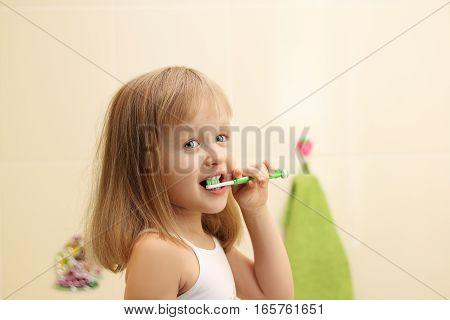 happy litle girl clean teeth in bathroom