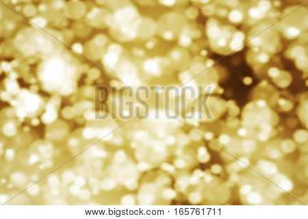 abstract gold glow glittering particles bokeh sparkle effect, event festive holiday happy new year concept