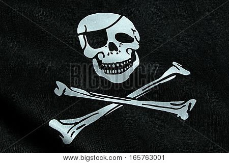 fabric texture of the pirate flag waving in wind calico jack pirate symbol hacker and robber concept