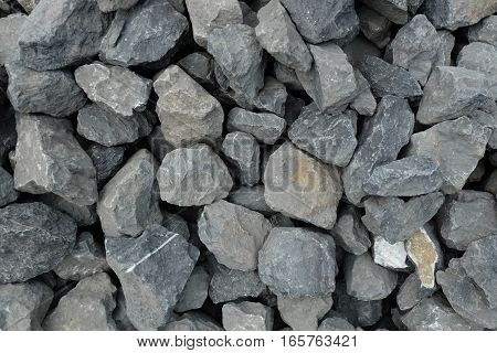 aggregate / gravel of very large gray stones at a stonepit