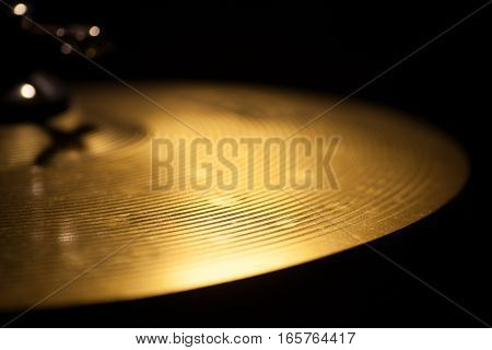 Close up shot of a cymbal in the dark.
