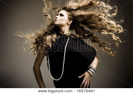 Portrait of a beautiful girl with flying blond hair poster
