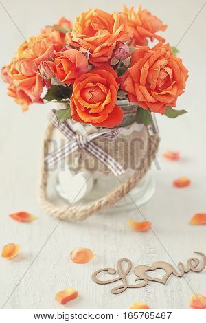 Lovely bunch of flowers .Beautiful fresh roses flowers in a vase decorated with a heart .