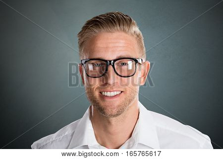 Photo Of Handsome Smiling Young Businessman With Eyeglasses