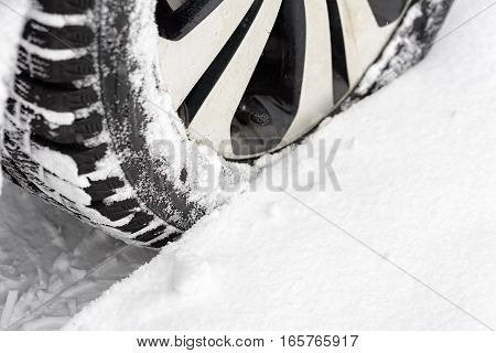 Car in the snow. Closeup of car tires in winter