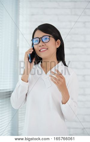 Pretty young business lady talking on the phone