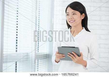 Pretty business woman with digital tablet in hands