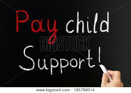 Person Hand Writing Pay Child Support With Exclamatory Sign On Blackboard With Chalk