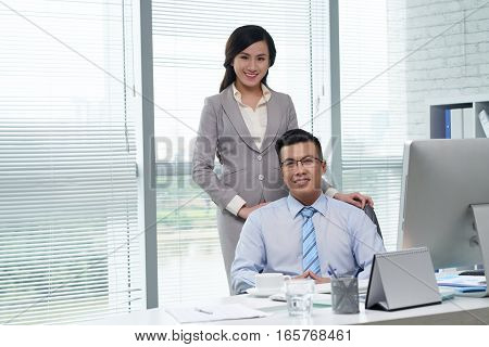 Portrait of Vietnamese business team of two
