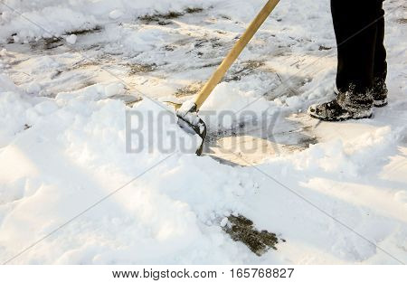 Removing snow with a shovel after snowfall