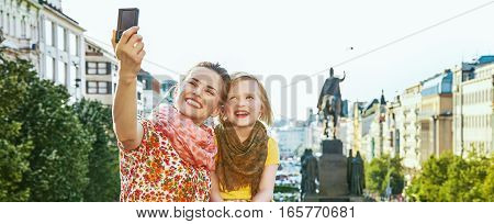 Mother And Daughter With Digital Camera Taking Selfie In Prague