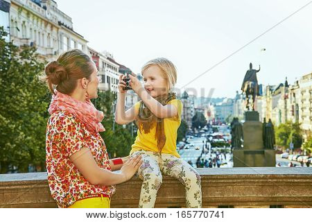 Mother And Child With Digital Camera Taking Photo In Prague