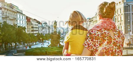 Mother And Daughter Tourists Exploring Attractions In Prague
