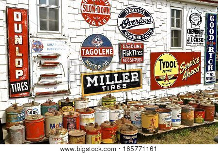 ROLLAG, MINNESOTA, Sept 1. 2016: Oil cans and  metal advertising signs of oil companies are displayed on an old filling station wall at the West Central Steam Threshers Reunion in Rollag, MN attended by 1000's held annually on Labor Day weekend.