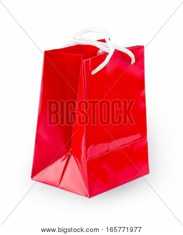 Shopping red paper bag template with clean blank. Single cardboard package with rope handles mock up isolated on white background