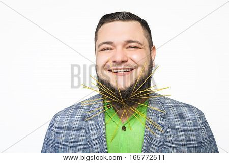 fat bearded man stuck in his beard spaghetti and smiling over white background