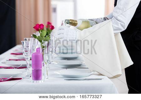 Close-up Of Waiter Pouring Champagne Into Glass