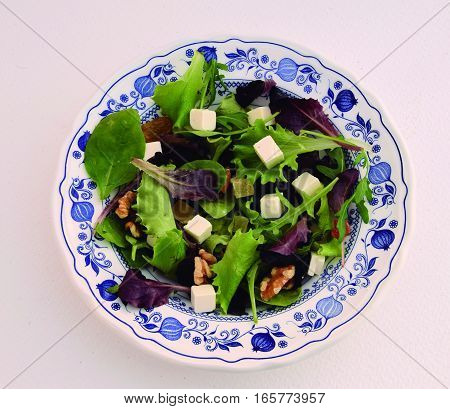 Salad. Exquisite salad dish with natural condiments