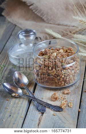 Granola berries and ears of wheat and oats. Healthy food.