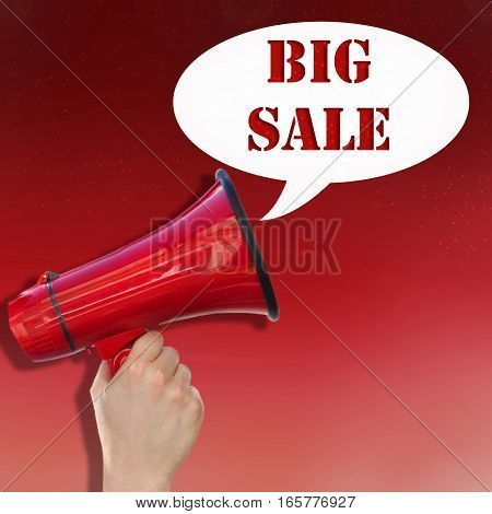 hand hanging a megaphone with text big sale on red background