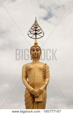 Golden big buddha statue in thai temple