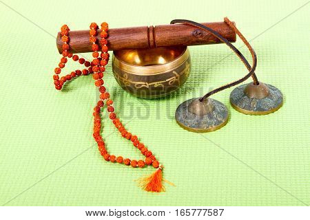 diverse ethnic objects for meditation and relaxation: singing bowl strike plates drums beads view from above
